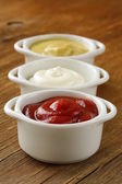 Mustard, ketchup and mayonnaise - three kinds of sauces — Stock Photo