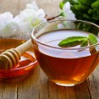 Stock Photo: Cup of tewith mint and honey on wooden table