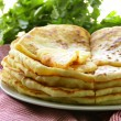 Pile of fried bread with butter and parsley — Stock Photo