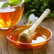 Cup of tea with mint and honey on a wooden table — Stock Photo