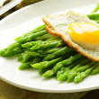 Gourmet breakfast - asparagus with fried egg - Stock Photo