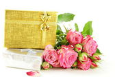 Pink roses and box with gifts on a white background — Photo