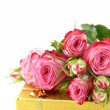 Stock fotografie: Pink roses and box with gifts on white background