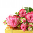 Stockfoto: Pink roses and box with gifts on white background