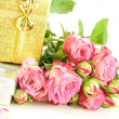 Stock Photo: Pink roses and box with gifts on white background