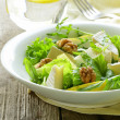 Stock Photo: Salad with pear, walnuts and cheese camembert
