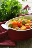 Vegetable stew with olives and red pepper — Stock Photo