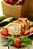 Roulade cake with cream and strawberries — Stock Photo