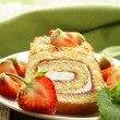 Roulade cake with cream and strawberries - Stock Photo