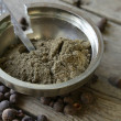 Ground black pepper on a wooden table — Stock Photo