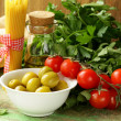 Still life of  olives,  herbs, cherry tomatoes and Italian pasta — Stock Photo
