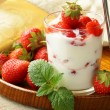 Dairy dessert - yogurt with fresh strawberries in glass — Stock Photo #25879503