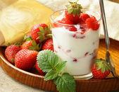 Dairy dessert - yogurt with fresh strawberries in a glass — Stock Photo