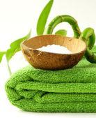 Sea salt and towel - green spa concept — Stock Photo