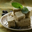 Traditional oriental dessert halva - sunflower seeds and sugar — Stock Photo