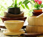 Wooden kitchen utensils on natural background — Stock Photo