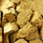 Gold nuggets many pieces as the background — Stock Photo
