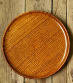 Empty wooden plate on the old wooden table — Stock Photo