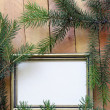 Christmas wooden background gold frame and fir tree branches — Stock Photo