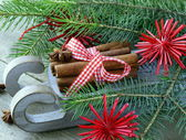 Christmas composition - a wooden sleigh with gifts and fir tree branches — Stock Photo