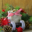 Christmas composition - wooden sleigh with gifts and fir tree branches — Stock Photo #27117987