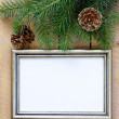 Christmas wooden background gold frame and fir tree branches — Stock Photo #27599791