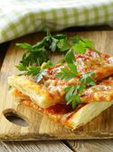 Pizza of puff pastry with tomato sauce and parsley — Stock Photo