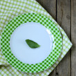 Empty plate with green cell  on the wooden background — Stock Photo