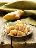 Sugared ginger (candied) and fresh root on a wooden table — Stock Photo