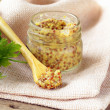 Traditional dijon mustard in a glass jar — Stock Photo