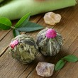 Exotic green tea in the form of a flower on a wooden table — Stock Photo
