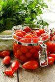 Snack tomatoes pickled with herbs and spices — Stockfoto