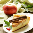 Piece of homemade apple pie with cinnamon on a wooden table — 图库照片 #28632909