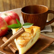 Piece of homemade apple pie with cinnamon on a wooden table — ストック写真