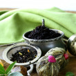 Assortment of tea - black leaf, green, exotic and tea strainers — Stock Photo