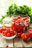 Snack tomatoes pickled with herbs and spices — Stock Photo