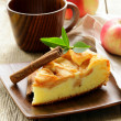 图库照片: Piece of homemade apple pie with cinnamon on a wooden table