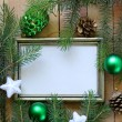 Christmas green fir tree branches with beautiful decorations on wooden background — Stock Photo