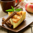 Piece of homemade apple pie with cinnamon on a wooden table — Stock Photo
