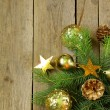 Christmas green fir tree  branches with beautiful decorations on wooden background — Zdjęcie stockowe
