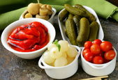 Pickled snacks (tapas) - mushrooms, tomatoes, cucumbers and pearl onions — Stock Photo