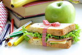 Sandwich with ham, apple, banana and granola bar - healthy eating, school lunch — Stock Photo