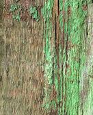 Tavola di legno vecchio sfondo sgangherata con vernice verde — Foto Stock