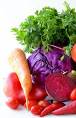 Assorted different red vegetable (tomato, pepper, chili, carrots, beets, cabbage, radishes) — Stock Photo