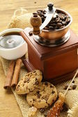 Still life of wooden coffee grinder, sugar, biscuits — Stock Photo