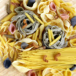 Stock Photo: Different kinds of past(spaghetti, fusilli, penne, linguine)