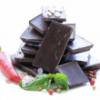 Gourmet dark chocolate with chili pepper, sea salt and basil — Stock Photo