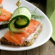 Sandwich with red fish (salmon) and dill — Stock Photo