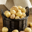 Fresh organic potatoes on a wooden background, rustic style — Stock Photo #30217187