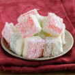 图库照片: Turkish delight (rahat lokum) dessert in coconut flakes